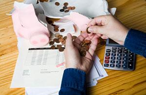 debt-piggy-bank-iStock_000007403861_300px